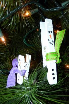 snowmen tree pins. my kids would love crafting these!
