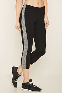 A pair of stretch knit athletic leggings featuring marled knit paneled sides, moisture management, a hidden key pocket, and an elasticized waist.