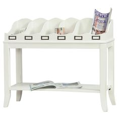 Finally, a console table for the entry that functions the way most families' entries do:  As a catch-all for mail, keys, goodness knows what other stuff.  Clever design. Wood console table in distressed white with 6 top storage compartments and a bottom display shelf. Product: Console table...