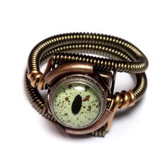 The steampunk wire-work ring - would make a great bracelet with an opal instead of eyeball