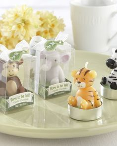 Grr! With a tiny, baby-sized roar, these adorable mini jungle animal baby shower candles will light up your baby shower as favors or table decorations.