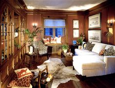 Love the animal prints and colors. Picure say color is Donald Kauffman DKC 16 but looks more like DKC 35. Similar to Valspar Paprika? Love it with dark floors.  Bridge Design Studio traditional family room