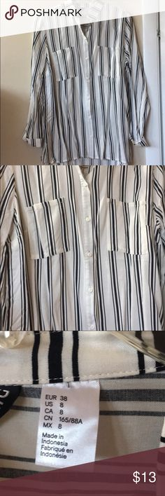 Black and white striped long sleeve H&M black and white long sleeve button down shirt. New with tags attached, never worn. Size 8 H&M Tops Button Down Shirts