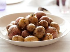 I have been cooking this recipe for 7 years now and I'm happy to share it on this Pin it... NOw that's awesome... Roasted Baby Potatoes with Herbs from FoodNetwork.com
