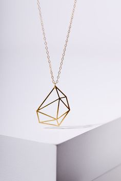 MIZYAN's gold plated cubic necklace, geomertic accessories