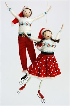 Halinka's Fairies-Santas Skaters-Designed and hand made by Halinka this pair of skaters are dressed in the colours of Christmas. The girl has a spotty skirt in either red or duck egg blue , a cream jumper and a red velvet hat. The boy has red or duck egg blue trousers, cream jumper and a red velvet hat. They measure approximately 13 to 14cm tall