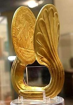 Elamite gold armlet ca1200 BCE , This Item was found in arjan-Behbahan (during constructin works of a dam ) in an ancient grave in 1982, the cuinform inscription of this armlet shows that it belonged to Elamite king Kidin Hotran, Iran national museum.