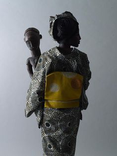 """WAfrica-Ankara Japanese kimonos by Cameroonian designer Serge Mouangue The name WAfrica is a combination of the word for Japanese spirit, """"wa,"""" and Africa. """"In I experimented with Japanese. Traditional Japanese Kimono, Traditional Dresses, Kimono Design, Textile Design, African Artists, Face Characters, African Design, West Africa, African Fabric"""