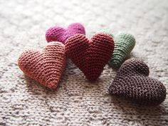 Puffy hearts crocheted in the round.