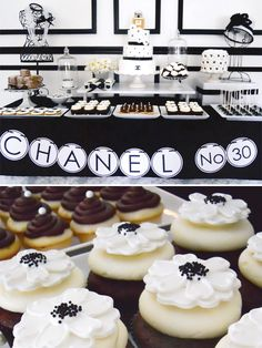 Black & white Coco Chanel inspired dessert table with camilla flower cupcakes @Jenn L Bell with the Mostess