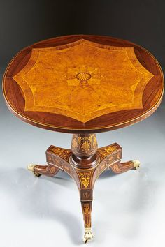 "A remarkable tilt top table of ""Etruscan"" design probably by Gabriele Capello (1806-1879) commonly known as ""Il Moncalvo"". Turin, Italy, circa 1840. Capello often collaborated with designer Filipp Pelagio Pelagi (1775-1860). Pelagi was in charge of the decoration of Royal Palaces including Racconigi. The classical anthemia and floral motifs and use of exotic woods are indicative of the Etruscan designs employed by Pelagi."