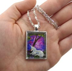 Do you - or a friend - need blessings from a unicorn? Capture the magical powers of Beauty. Click the link in my bio to shop #FantasyArtPendants #ByKKSwann feat. @DrakeyArt! ### #feedyourwhimsy #drakeyart #fantasyart #fantasyartnecklace #necklace #handmadenecklace #designernecklace #unicorn #whiteunicorn #magical #blessings #forest #unicornnecklace #unicornpendant #unicornjewelry #beauty - By KK Swann Fantasy Art Pendants featuring Drakey Art