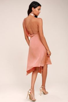 Be at the forefront of fashion with the Keepsake Sidelines Blush Pink Midi Dress! Woven poly, with a slight sheen, forms a draping bodice with a skinny strap that zigzags across the open back, creating a chic, minimalist look. Midi skirt with asymmetrical hem. Hidden side zipper.