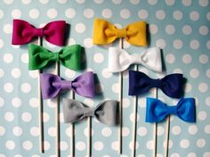 "Cute ""bow tie on a stick"" idea for a family or group picture!"