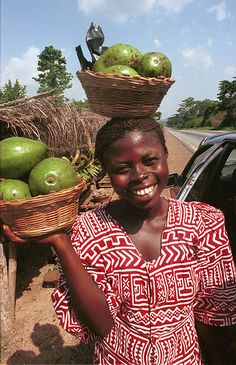 Street vendor selling avocado along the road, Komasi, Ghana