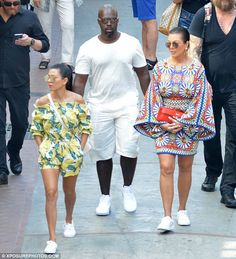 Going for a bold look: Meanwhile Kris wore a colourful patterned dress with…