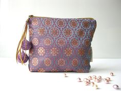 Travel make up pouch silk golden by Bags By Travelher.