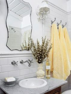 Vintage Flair - love the wall faucet! The goal of this bathroom was to conserve space while providing durable, kid-proof surfaces. The vanity is crafted from a marble slab mounted on a bureau. The wall-mount faucet conserves counter space around the sink. Beautiful Bathrooms, Modern Bathroom, Master Bathroom, White Bathroom, Simple Bathroom, Bad Inspiration, Bathroom Inspiration, Baños Shabby Chic, Rustic Mirrors