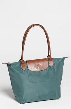 Free shipping and returns on Longchamp 'Small Le Pliage' Shoulder Bag at Nordstrom.com. Embossed leather trims a water-resistant nylon tote that folds into a compact shape for storage.