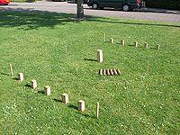 Kubb: houten blokken gooien in Zweeds spel - Speluitleg, regels, geschiedenis en uitspraak