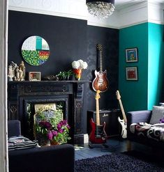 Like the black wallpaper, fireplace details, teal accent wall and guitar placement