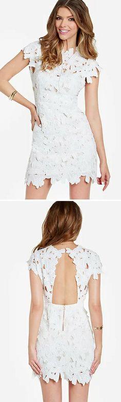 white lace dress with cutout back