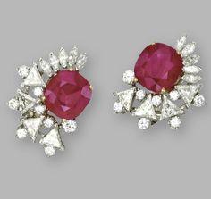 PAIRᅠ OFᅠ RUBYᅠ ANDᅠ DIAMONDᅠ EARCLIPS    Cushion-shapedᅠ rubiesᅠ weighingᅠ 6.29ᅠ andᅠ 6.41ᅠ carats,ᅠ triangular-shaped,ᅠ marquise-shapedᅠ andᅠ roundᅠ diamondsᅠ weighingᅠ approximatelyᅠ 5.75ᅠ carats,ᅠ mountedᅠ inᅠ platinum,ᅠ signedᅠ Cartier. [These would be outstanding with a fall of diamonds hanging off of them]