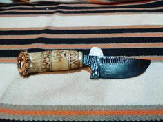 Check out this item in my Etsy shop https://www.etsy.com/listing/251539157/chickasaw-skinning-knife-2006