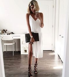White is a winner again for a night out or with friends ... a white/black basic combo is classic and works every time. Strappy heels accentuate the slit skirt ~ add some glimmer on your wrists for fun and don't come home til dawn!
