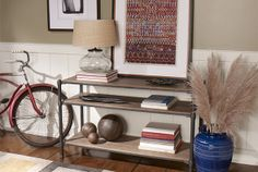 We love it when style combines with practicality! This Trekker console table makes a great storage solution for your entryway.