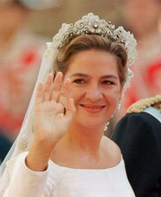 Infanta Cristina on her wedding day, 4 Oct. 1997.  She wore, among other things, her great-grandmother Queen Ena's diamond earrings.