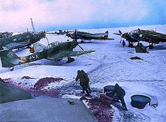 1943, A German airfield in the winter of Russia. Stuka dive bombers, a Junkers transport, & HE bombers hown...