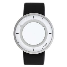 """3012 watch, grey-white  The stylish Hygge 3012 series is designed by Mats Lönngren. His aim was to create a """"frameless"""" design where the case is reduced to its minimum, leaving only the two round time indicators visible from the front view. The round discs provide a recognizable look and give this watch both character and functionality. Color and contrast are used to highlight the display and they make the 3012 series easy to use."""