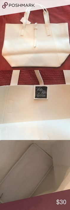 SAKS FIFTH AVENUE Vegan White Leather Tote SAKS FIFTH AVENUE Vegan White Leather Tote Small color transfer area. Great condition. Never used. Perfect pool or beach bag Saks Fifth Avenue Bags Totes