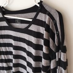 "GAP striped dolman tee. relaxed super soft striped dolman 3/4 sleeve tee from GAP.  black and heather grey 1"" yarn dye stripes.  100% cotton.  small 4 hole black buttons on upper left shoulder.  size s.  slight curve to bottom hem. GAP Tops Tees - Long Sleeve"