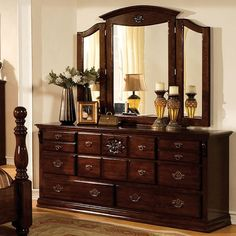 Tuskan II Dresser CM7571DComplement your room with the gentle curves of this classic bedroom set. Beautiful blunt arrow feet and sleek round finials adorn the bed. The romantic setting is further enhanced by the glossy dark pine finish, decorative headboard and the unique tri-fold mirror.Features:Traditional StyleAntique Gold Handles Solid Wood, Wood Veneer