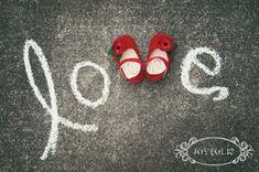 Adorable photo with baby shoes, but use bows! More