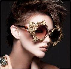Mercura golden baroque sunglasses in examiner  http://www.examiner.com/list/top-ten-sunglasses-that-are-cool-hot-green-iconic-creative-celebrity-worn/mercura-nyc TOP TEN GLASSES THAT ARE COOL 2013