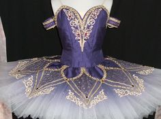 This is a highly professional tutu. Suitable for many classical roles like Raymonda, Corsaire, and many other variations. The color of this tutu is deep dark blue. The bodice is made with silk taffeta