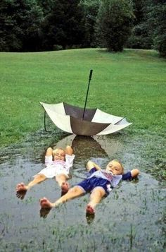 Love A Rainy Day. Kids lying in a mud puddle, water puddle actually ditched the umbrella for fun, so cute! I Love Rain, Rain Dance, Under My Umbrella, Rain Umbrella, Singing In The Rain, Beautiful Children, Little People, Rainy Days, Rainy Day Fun