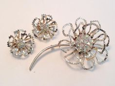 Sarah Coventry Vintage Set Allusion. Vintage brooch with pale gold toned lacy metal and matching vintage earrings. Signed Sarah Coventry.