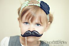 Love the hairband and look at the mustache.