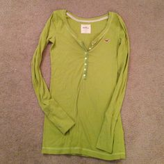 Hollister long sleeve Henley. Worn once or twice! Super cute bright green(not neon) long sleeve Henley tee. I have it in white as well and will throw that in for free as it has been worn quite a bit more but could still get some use. But hey free shirt! Hollister Tops