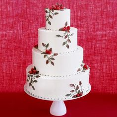 cake decorated with fresh raspberries, buttercream vines and fondant leaves.  perfect for a summer country wedding.  by Jim Smeal.