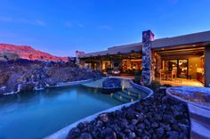 Snow Canyon, Utah.  5,458 square feet.  3 bedrooms, 3.5 bathrooms.  Exposed beam ceilings, hickory floors inlaid with walnut.  Includes pool + additional outdoor kitchen & dining.  360-degree views of Snow Canyon State Park.