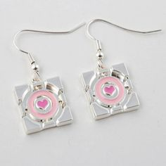 Try on these Portal Companion Cube earrings. Companion Cube, Cubes, Nerd Jewelry, Unique Jewelry, Portal 2, Prom Outfits, Geek Culture, Geek Chic, Try On