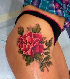 The deep colored peony tattoo is the signage of saturated love. A charming and sexy thigh tattoo.