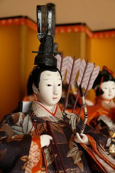 Hinamatsuri, also called Doll's Day or Girls' Day, is a special day in Japan. Hinamatsuri is celebrated each year on March 3. Platforms covered with a red carpet are used to display a set of ornamental dolls representing the Emperor, Empress, attendants, and musicians in traditional court dress of the Heian period.