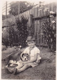Vintage photo of a boy and his dog, 1930.