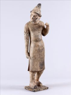 Marchand - VIIe siècle – début VIIIe siècle, Dynastie des Tang (618 – 907)  Terre cuite  H : 52 cm l : 15 cm